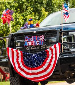 God Bless America on front of truck